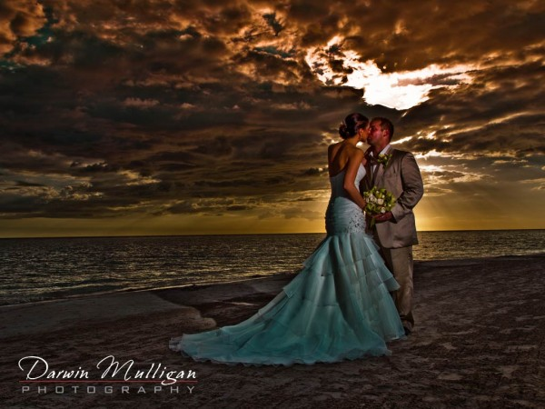 Romantic sunset kiss on the beach at Sandals Whitehouse, Jamaica
