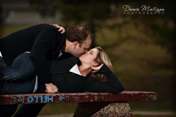 kissing on the bench engagement photos testimonial