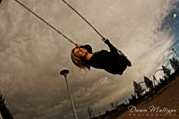 on a swing engagement photos in edmonton