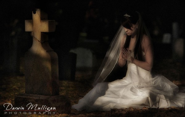 bride in a graveyard on wedding day