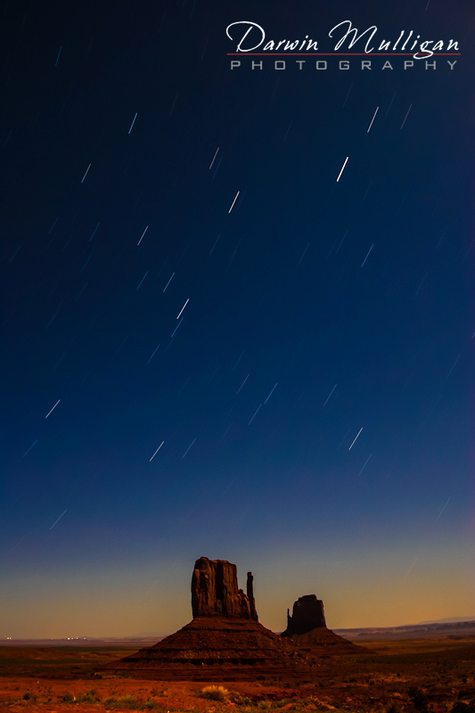 The Mittens at Monument Valley captured at full moon showing Star Trails