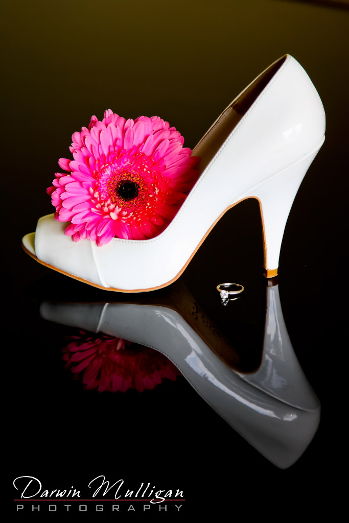 Bride's shoe and reflection from piano