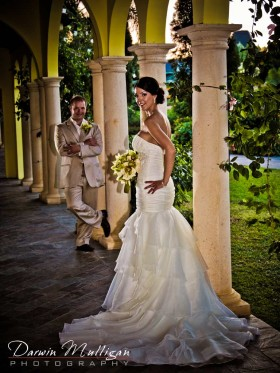 Bride and Groom pose at Sandals Whitehouse at their Jamaica Destination Wedding