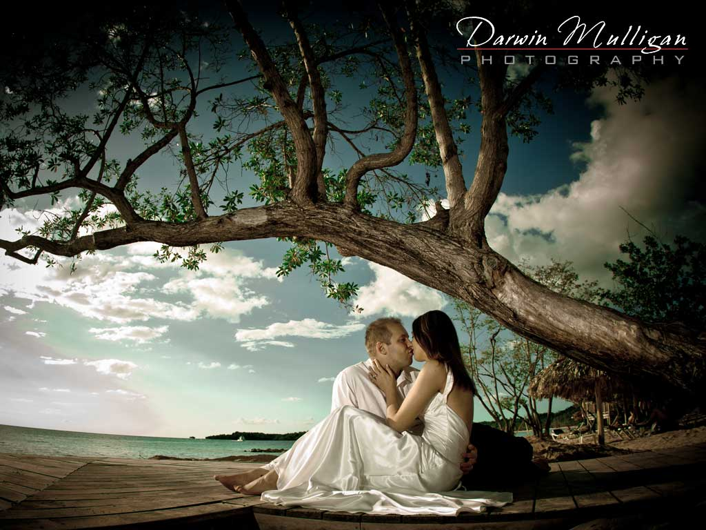 Bride and Groom kiss on the beach on a romantic destination wedding in Jamaica