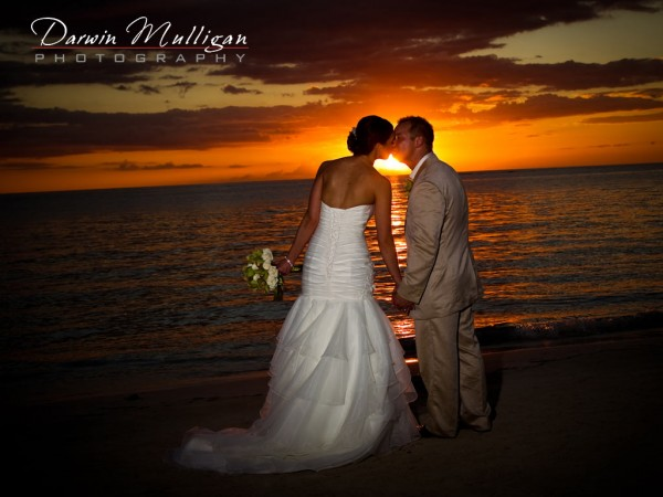 Sunset kiss on the beach in Jamaica on their destination wedding
